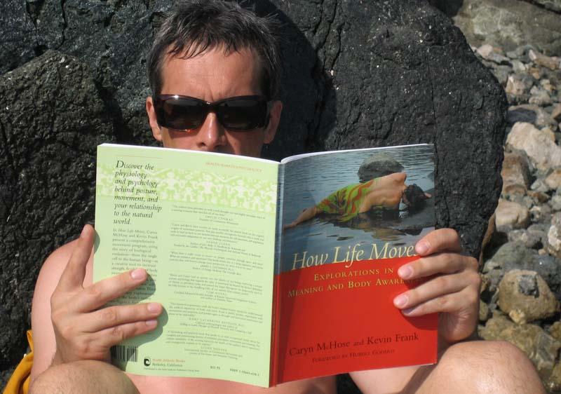 Malcolm reading a book